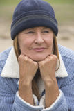 Relaxed confident woman warm bonnet outdoor Royalty Free Stock Photography
