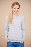 Relaxed confident young blond woman Royalty Free Stock Photo