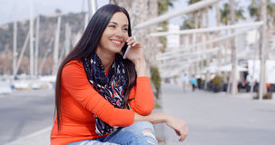Relaxed confident young woman on a mobile Royalty Free Stock Photography