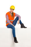 Relaxed Construction Worker Woman Sittting On White Box Stock Photography