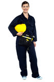 Relaxed construction worker with yellow helmet Stock Photo