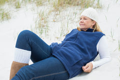 Relaxed contemplative senior woman at beach Royalty Free Stock Image