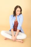 Relaxed Content Attractive Young Woman Sitting on the Floor Stock Image