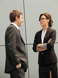 Relaxed conversation between two business persons Royalty Free Stock Image