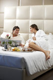 Relaxed Couple in Bed Stock Photo