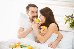 Relaxed Couple in Bed in bedroom at home Stock Image