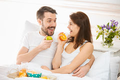 Relaxed Couple in Bed in bedroom at home Stock Images