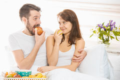 Relaxed Couple in Bed in bedroom at home Stock Photo