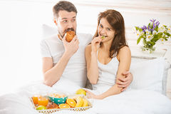 Relaxed Couple in Bed in bedroom at home Royalty Free Stock Image
