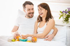 Relaxed Couple in Bed in bedroom at home Stock Photos