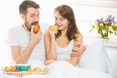 Relaxed Couple in Bed in bedroom at home Royalty Free Stock Photos