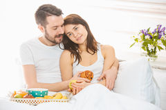 Relaxed Couple in Bed in bedroom at home Stock Photography