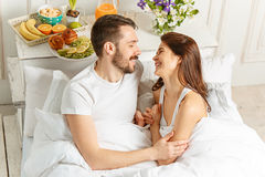 Relaxed Couple in Bed in bedroom at home Royalty Free Stock Photo