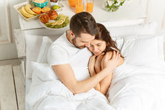 Relaxed Couple in Bed in bedroom at home Royalty Free Stock Photography