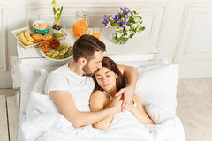 Relaxed Couple in Bed in bedroom at home Royalty Free Stock Images