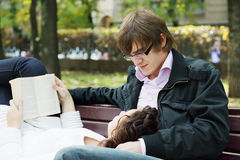 Relaxed couple with book Royalty Free Stock Photography