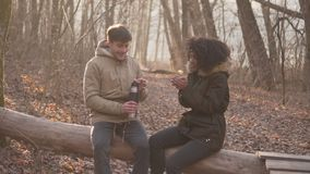 Relaxed couple drinking tea from thermos stock video footage