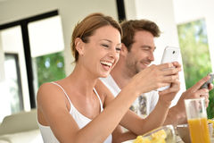 Relaxed couple eating breakfast on holidays royalty free stock images