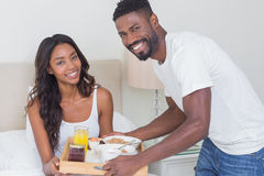 Relaxed couple having breakfast in bed together Royalty Free Stock Photos