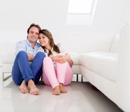 Relaxed couple at home Stock Images