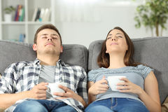 Relaxed couple resting at home on a couch Stock Image