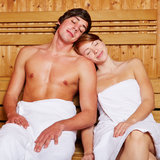 Relaxed couple in a sauna Stock Images