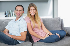 Relaxed couple sitting on the couch together Royalty Free Stock Photos