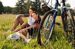 Relaxed Couple Sitting In Meadow Stock Photography
