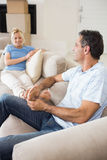 Relaxed couple sitting on sofa in the living room Stock Photos