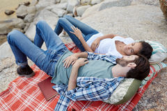 Relaxed couple taking a nap at a picnic Stock Image