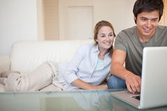 Relaxed couple using a notebook Stock Photos