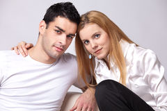 Relaxed couple watching TV Stock Images