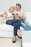 Relaxed couple with wine glasses at home Royalty Free Stock Photos