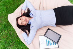 Relaxed delighted woman resting on the blanket Royalty Free Stock Photos
