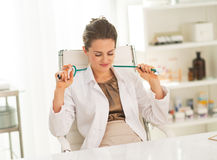 Relaxed doctor woman in office Stock Photos