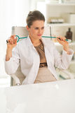 Relaxed doctor woman in office Royalty Free Stock Image