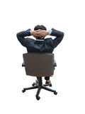 Relaxed and dreaming business man sits on office chair Royalty Free Stock Photos