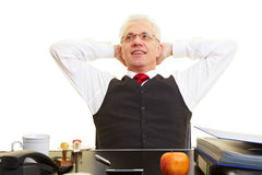 Relaxed elderly businessman Stock Photo