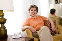 Relaxed elderly woman stock photos