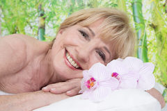 Relaxed elderly woman in spa Royalty Free Stock Photo