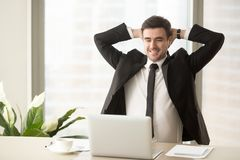 Relaxed employee enjoying result of good job done royalty free stock images