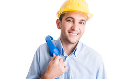 Relaxed engineer or architect holsding phone Stock Image