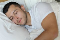 Relaxed ethnic male sleeping like a baby.  Stock Images