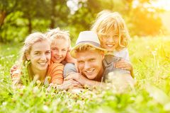 Relaxed family and children on vacation in summer. Relaxed family and children lie in a meadow on a summer vacation Royalty Free Stock Images