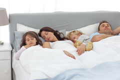 Relaxed family doing a nap together Stock Photo