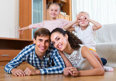 Relaxed family of four posing Royalty Free Stock Photo
