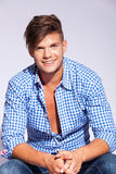Relaxed fashion male model wearing teeth braces. Looking and laughing to the camera Royalty Free Stock Photo