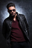 Relaxed fashion man in sunglasses and leather jacket Stock Photo