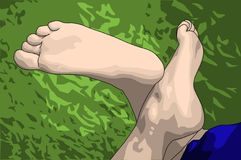 Relaxed feet on grass Stock Photography