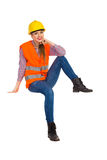 Relaxed Female Construction Worker Sitting Stock Photo